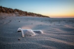 plastic cup on beach